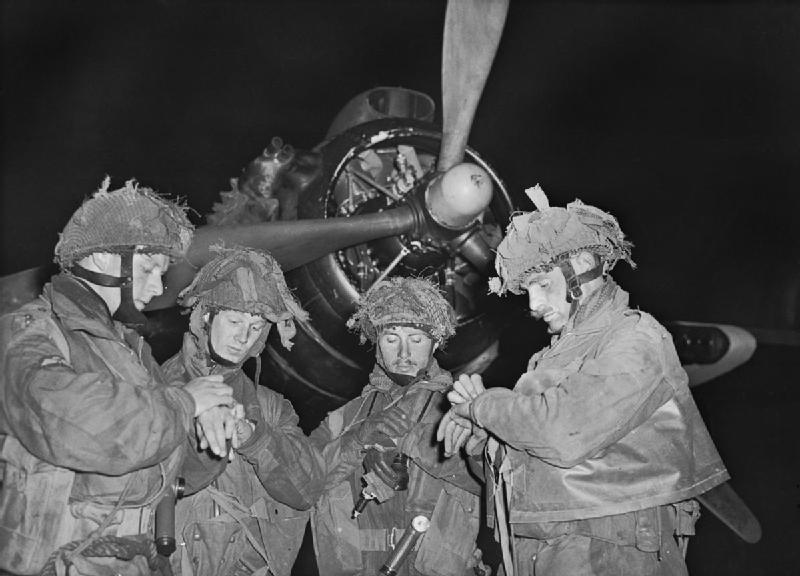 Four stick leaders of 22nd Independent Parachute Coy syncronise watches before loading into their bombers, 11pm 5th June 1944. H39070